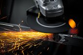 image of labourer  - Electric wheel grinding on steel structure in factory - JPG