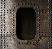 pic of battleship  - old metal porthole background - JPG