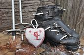 pic of ski boots  - old ski boots in a rustic setting with a heart shaped cushion - JPG