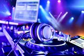 stock photo of disc jockey  - Dj mixer with headphones at a nightclub - JPG