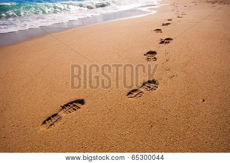 Footsteps On The Beach