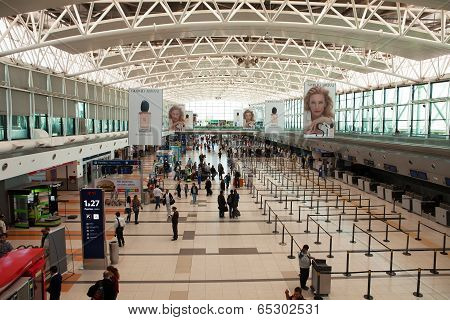 BUENOS AIRES, ARGENTINA - MAR 21 2014 : Passengers await checkin at Departures.