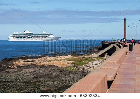MONTEVIDEO, URUGUAY - MAR 20 2014 : A cruise ship approached the port and passed the Rambla Francia.