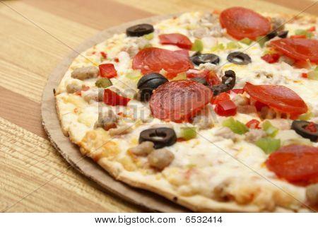 Deluxe Pizza de corteza delgada