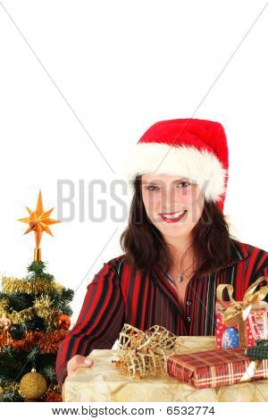 Young Woman In Santa Cap And Presents