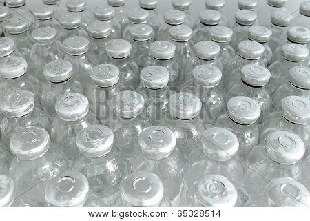 Bottles Of Medicine. Medical Manufacturing Background