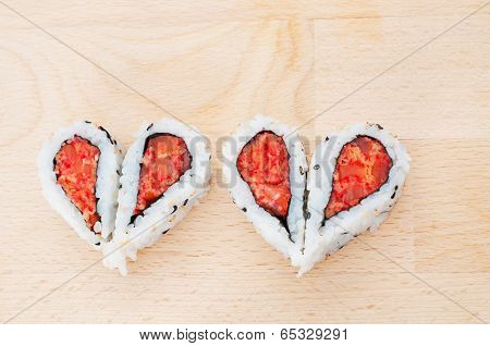 Love Sushi Concept With Four Pieces Of Sushi Forming The Two Hearts
