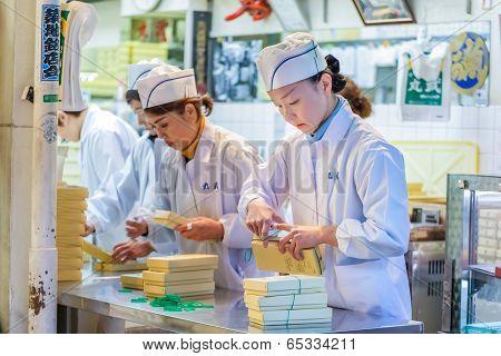 Japanese Worker at Tsukiji market in Tokyo