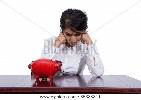 Angry businesswoman with piggy bank
