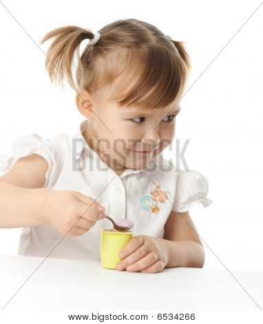 Little Girl Eats Yogurt
