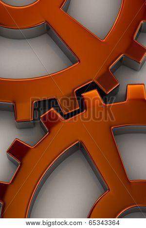 Interlocking gear wheels in orange over white background