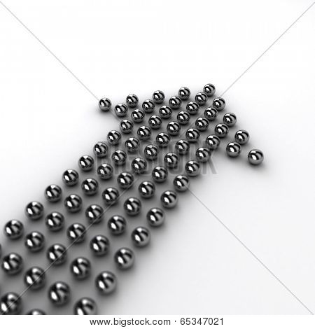 High resolution render of chrome spheres forming the shape of an arrow pointing upwards. Very shallow depth of field with focus on the single sphere on the very top.