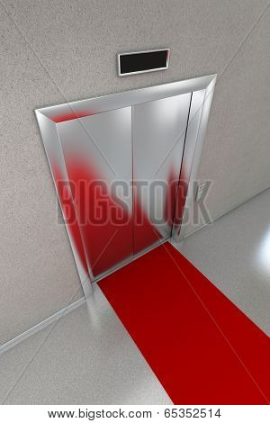Closed elevator with red carpet.