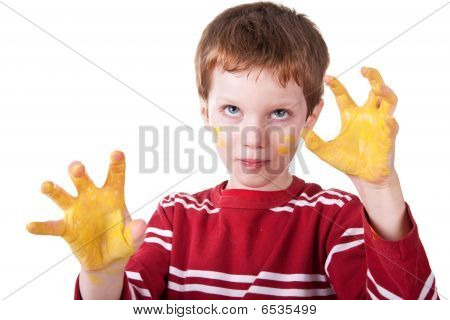 Kid Playing With Yellow Paint