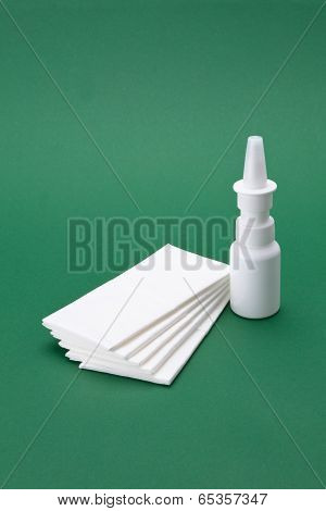 Nasal spray with white cloths bag in the green background