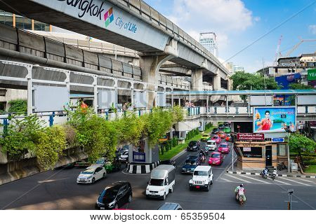 Multilevel Bangkok With Traffic On Street, Pedestrian And Skytrain Tracks
