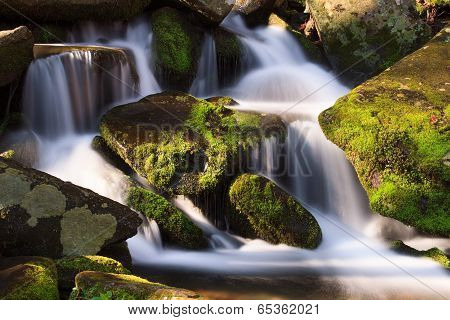 Cascade With Mossy Rocks