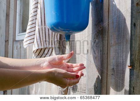 Closeup Of Gardener Girl Woman Wash Hands
