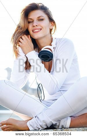 Amazing girl holds the headphones