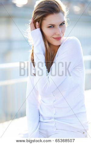 Beautiful woman touching her hair