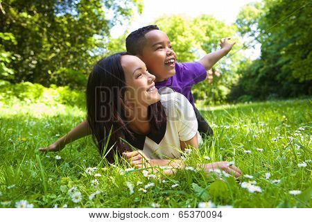 Mixed Race Mother And Son Smiling Outdoors