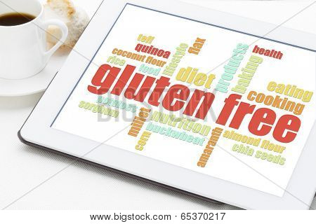 gluten free cooking word cloud on a digital tablet with a cup of coffee