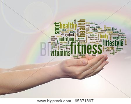 Concept or conceptual abstract fitness and health word cloud man hand, rainbow sky background