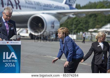 BERLIN, GERMANY - MAY 20, 2014: German Chancellor Angela Merkel (center) during open the International aviation and space exhibition ILA-2014.