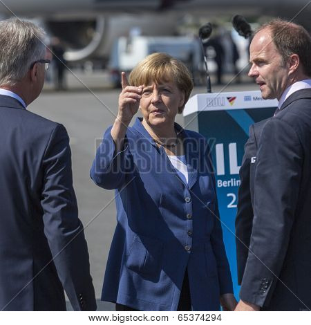 BERLIN, GERMANY - MAY 20, 2014: German Chancellor Angela Merkel (C) during open the International aviation and space exhibition ILA-2014.