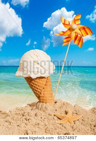 Vanilla flavor icecream with pinwheel on summer beach