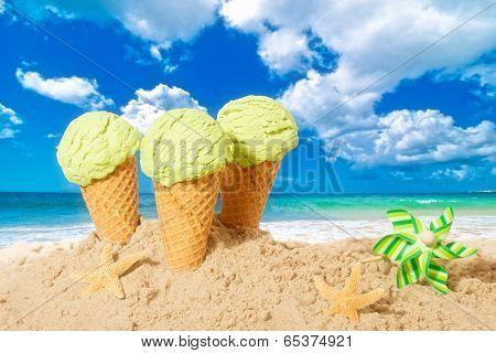 Minty flavor icecreams with pinwheel on summer beach