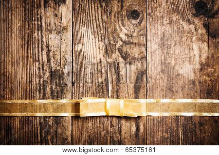 Old Board Background With Yellow Festive Ribbon.