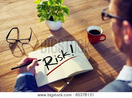 Man with a Notepad with Text Risk