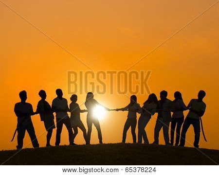 Silhouettes of People Playing Tug O Wars