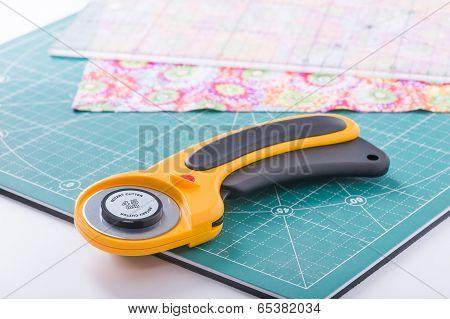 Rotary Cutter On A Green Mat
