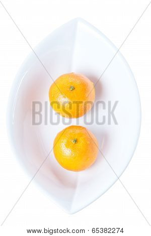 Two Tangerines In White Plate Isolated On A White Background