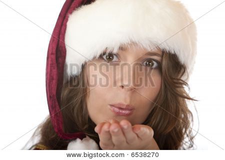 Santa Claus Woman With Christmas Cap Blowing On Palm