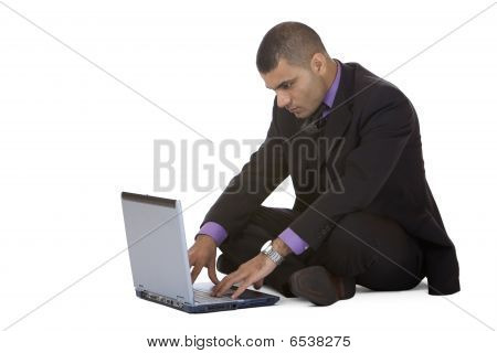Young handsome Business Man Works At Home With Computer Laptop