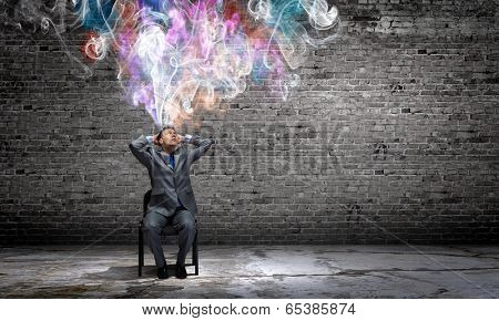 Young businessman thinking over the ideas. Creativity concept