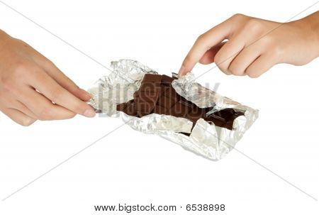 Young Girl With A Chocolate Bar In His Hand