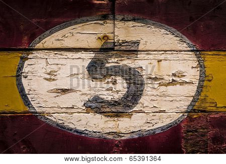 Old painted signs with  numerals. Number 5 from a series of numerals.