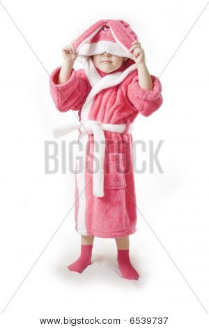 Small Girl Sittingin The Pink Bathrobe Of Bunny