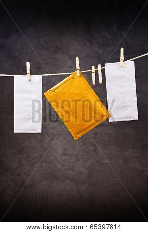 Three Envelopes On Clothes Rope