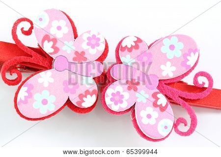 Pink Of Artificial Butterfly Hairpin Isolated On White.