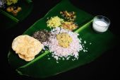 foto of indian food  - Tasty Indian breakfast is served on a sheet palm