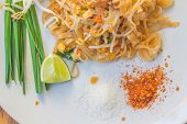 stock photo of egg noodles  - Noodles pad Thai is a thin rice noodles fried with tofu - JPG