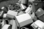 stock photo of landfills  - piles of old disused gas counters in a special waste landfill