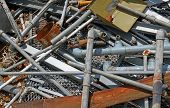 foto of ferrous metal  - Rusty pipe and more iron and metal material in a landfill of metallic material - JPG