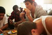 picture of crystal meth  - Gang Of Young Men Taking Drugs Indoors - JPG