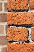 pic of mortar-joint  - The corner of an old building photographed close shows rustic colorful clay bricks - JPG